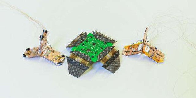 This Tiny 4-Gram Robot Jumps and Walks Using Memory Alloy Springs