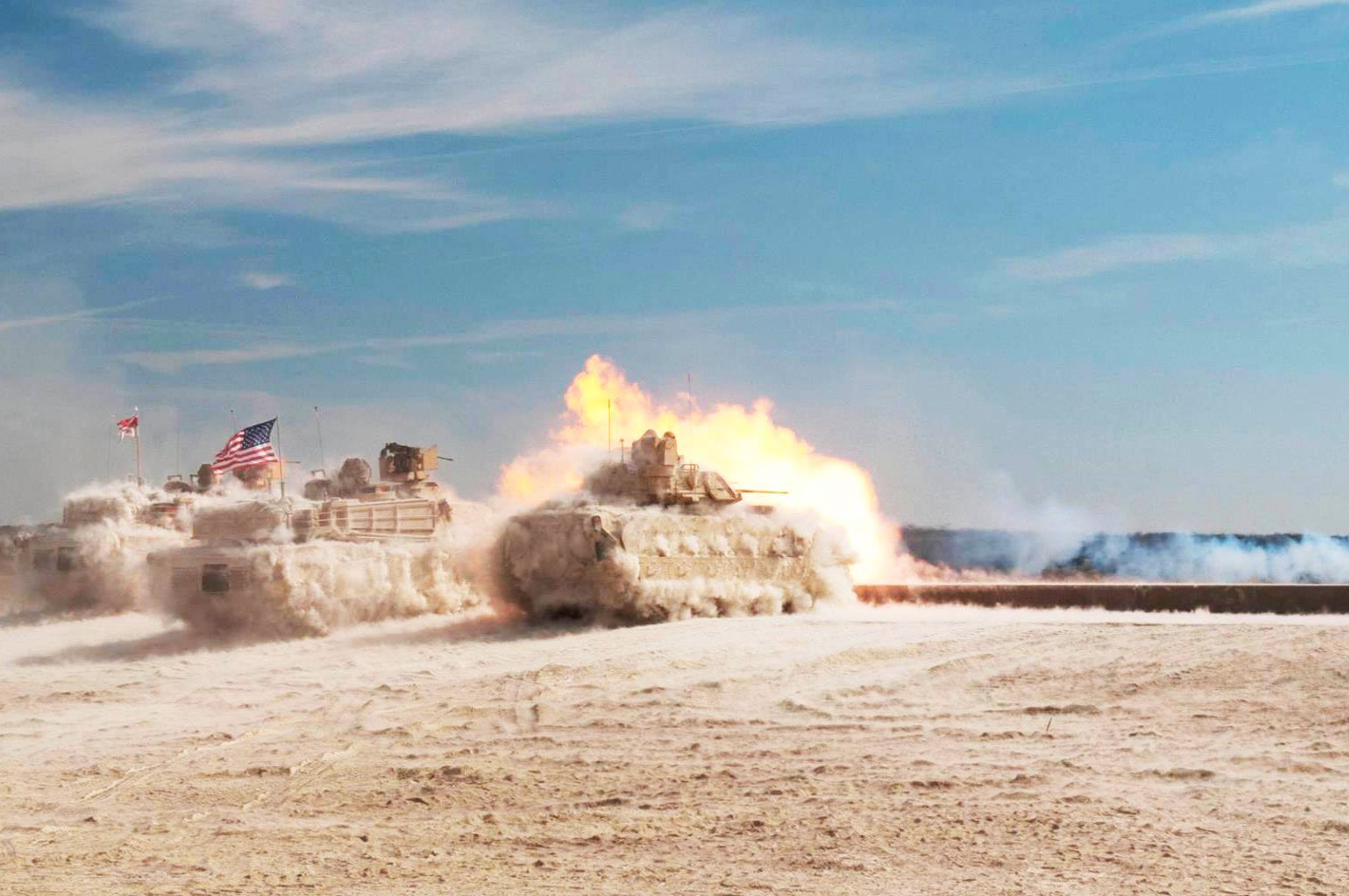 Amazing photo of M1 Abram tanks surrounded in a force field of dust after firing its cannon