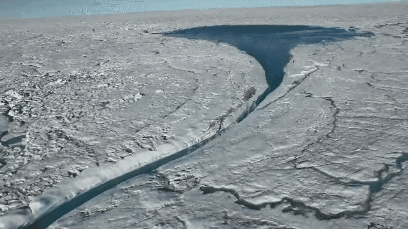 Crazy Drone Footage Shows a Huge Lake of Melted Ice in Greenland