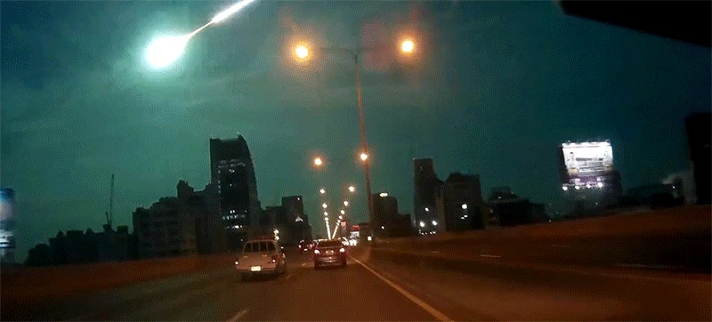 Spectacular meteor explosion lights up the night sky in a perfect alien blue