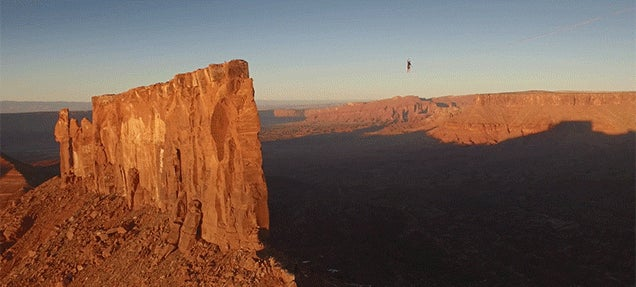 True bad arse walks a record breaking 1640 feet across a slackline at unbelievable heights