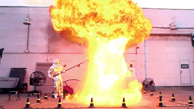 Pouring water on an oil fire creates a crazy mushroom cloud fire explosion