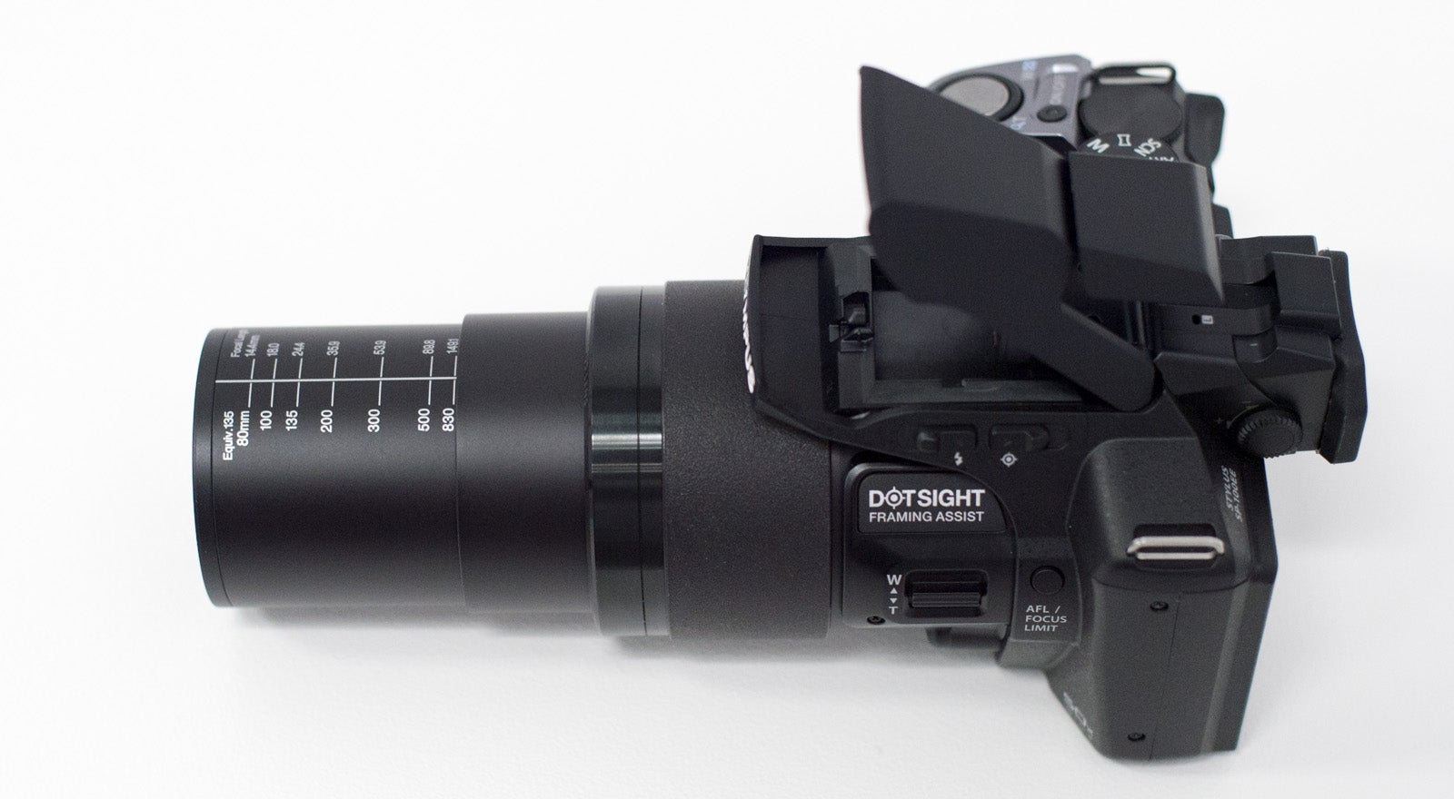 OLYMPUS SP-100 Is a 50X Superzoom Camera With a Red Dot Sight Like a Gun