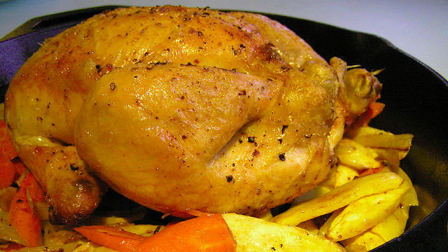Roast A Whole Chicken In Half The Time With A Preheated Frying Pan