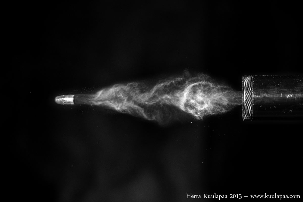 Awesome photo of a bullet cutting a card and other high-speed images
