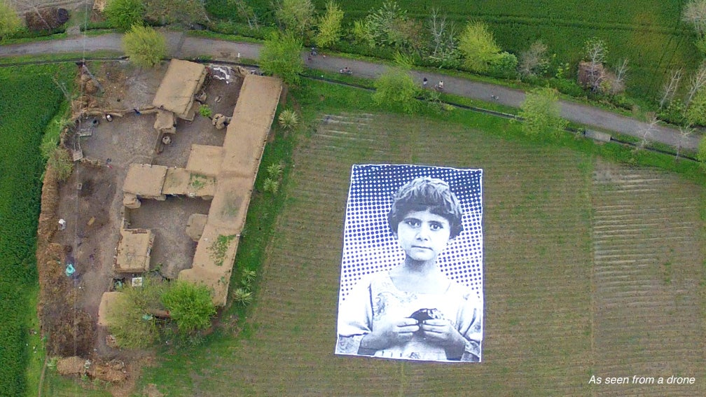 Giant Portrait Shows Drone Operators That People Aren't 'Bug Splats'