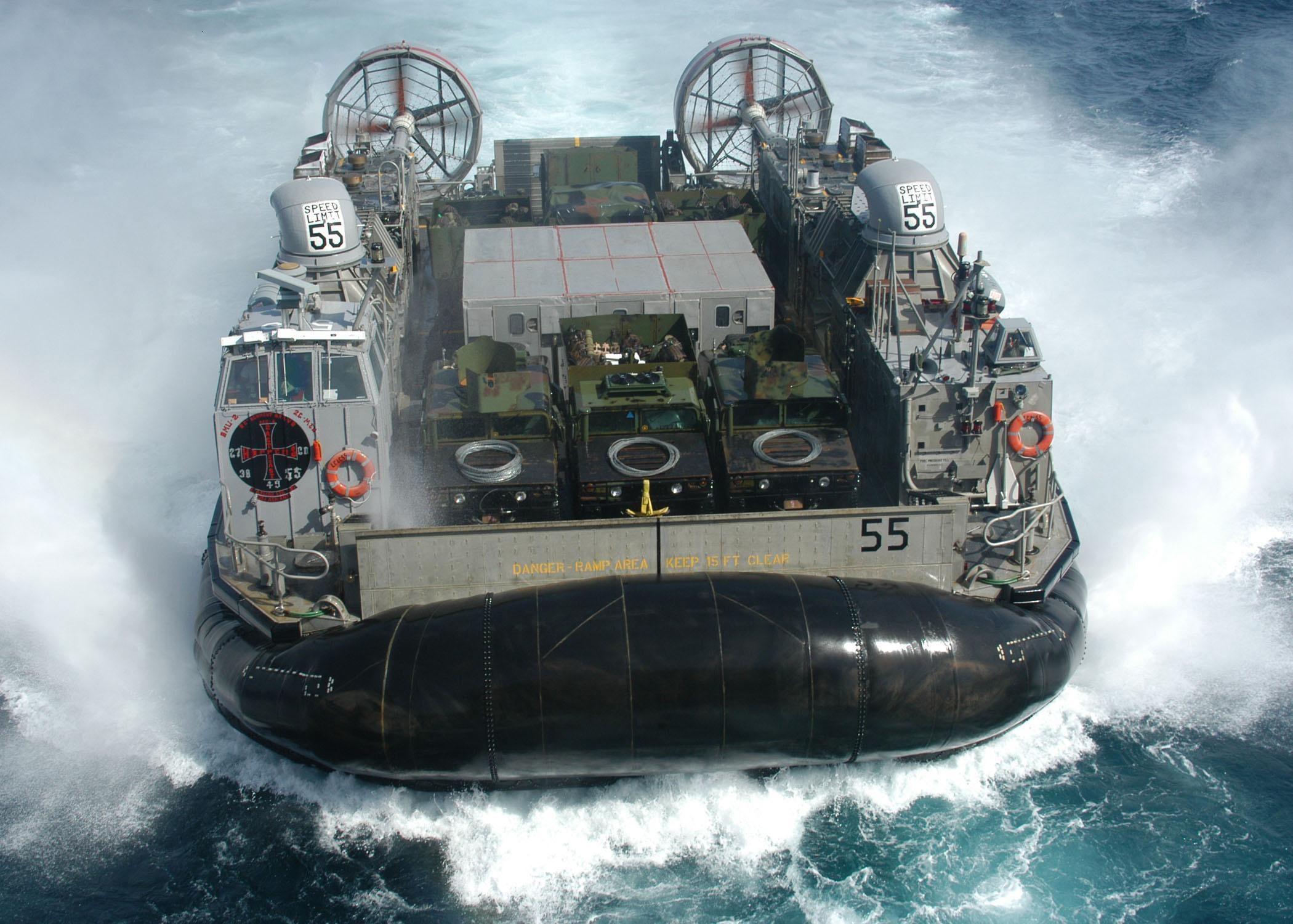 US Navy sailors inside an amphibious assault ship — or a lost Aliens scene