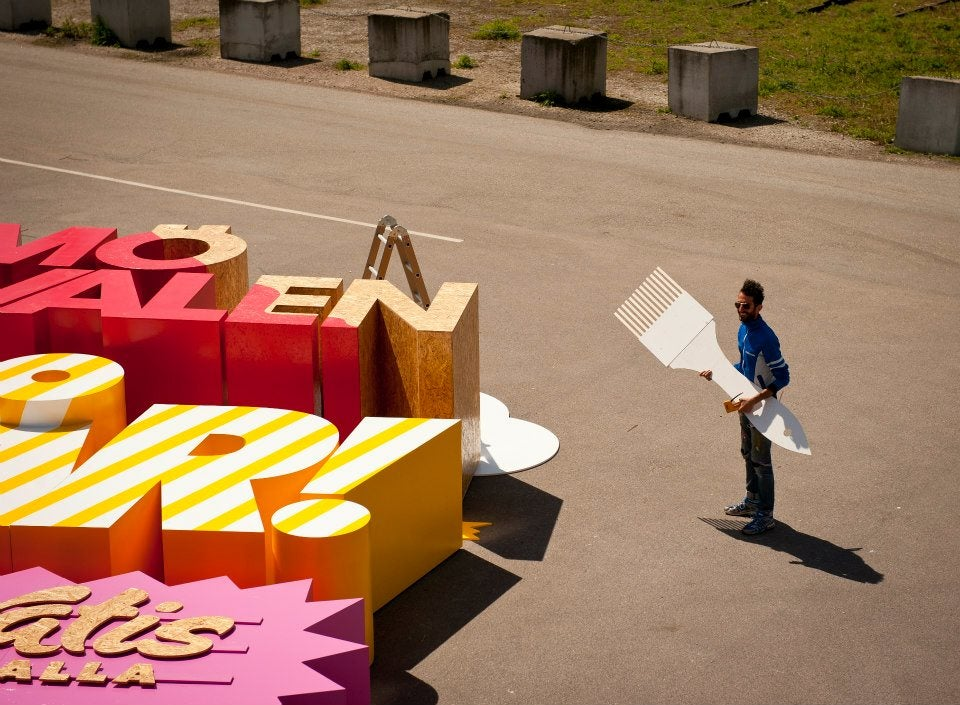 Cool 3D poster is made with letters so big that they can crush a human