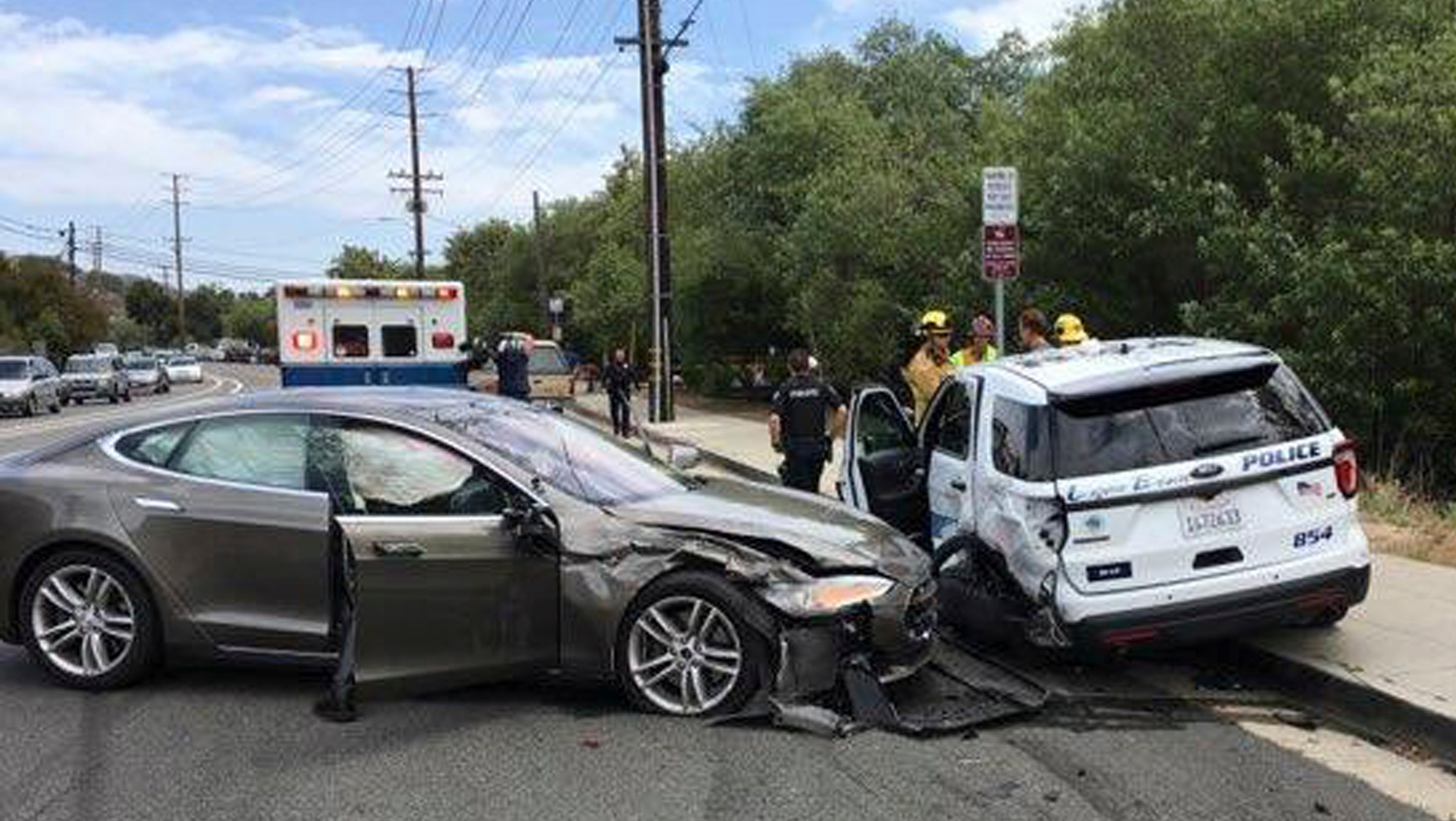 Tesla Car In Autopilot Mode Slams Into Parked Police Vehicle In California