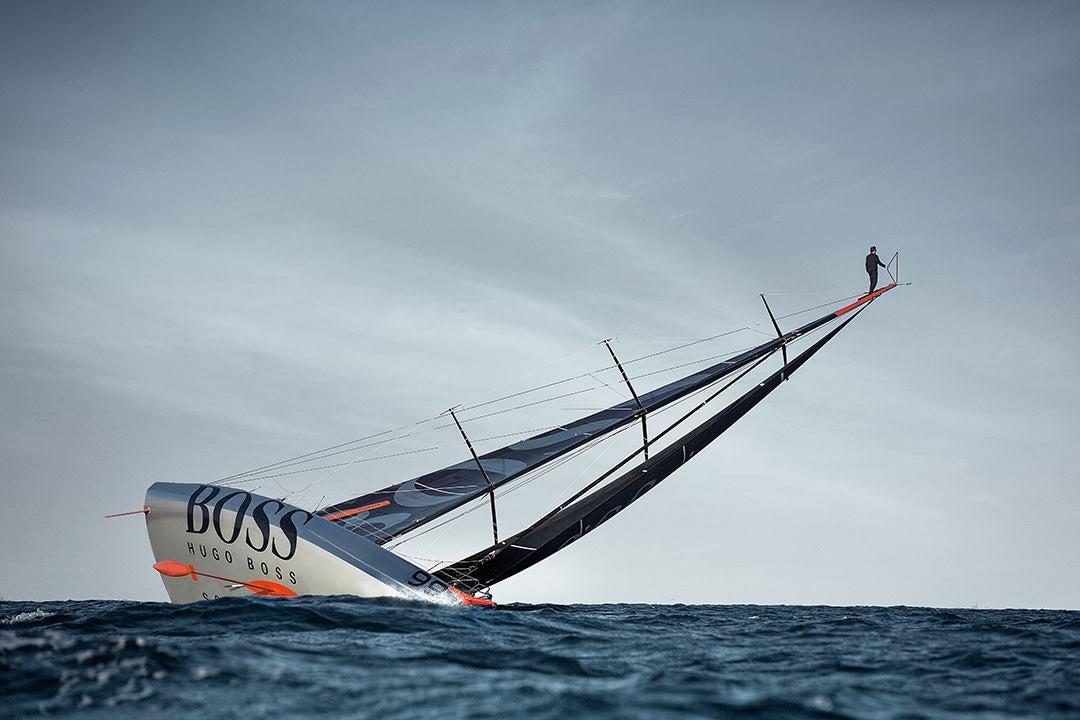 Spectacular stunt: Man runs up 98-foot ship mast and jumps into the sea