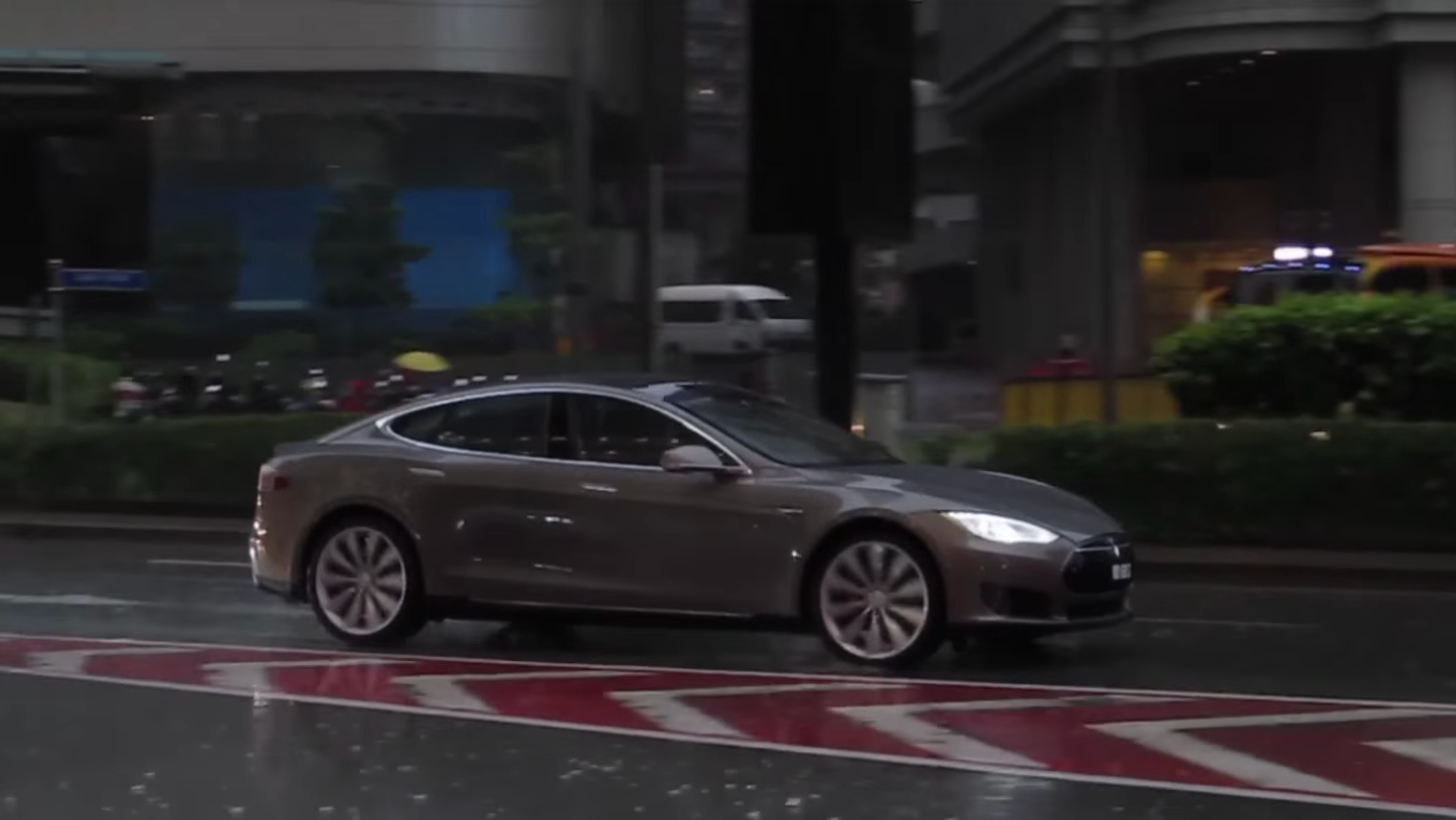 Tesla's Working On A Fix To Stop Its Wipers From Spraying People With Rainwater