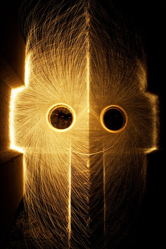 Light monster faces made of spinning molten metal