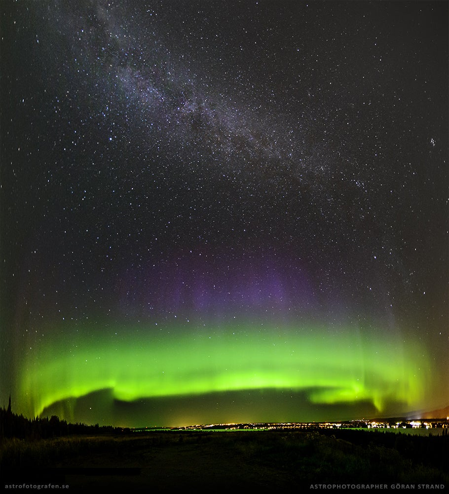 Incredible photo of the Milky Way rising over green and violet auroras