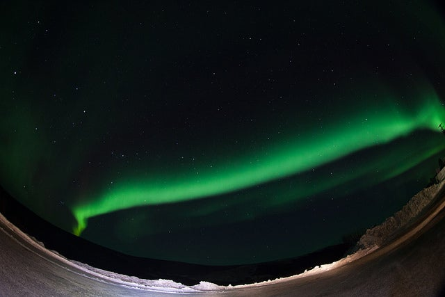 A NASA Rocket Soars Into an Emerald Aurora