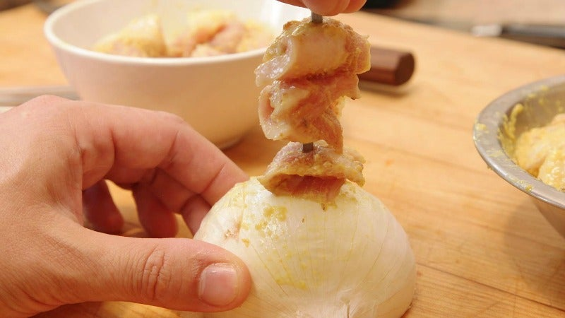 Skewer Food, Not Your Hands, With The Help Of An Onion
