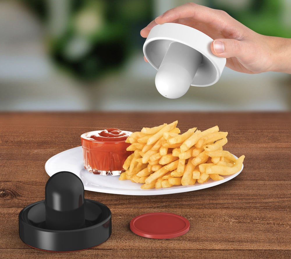 Paddle Salt and Pepper Shakers Bring Air Hockey To the Dinner Table