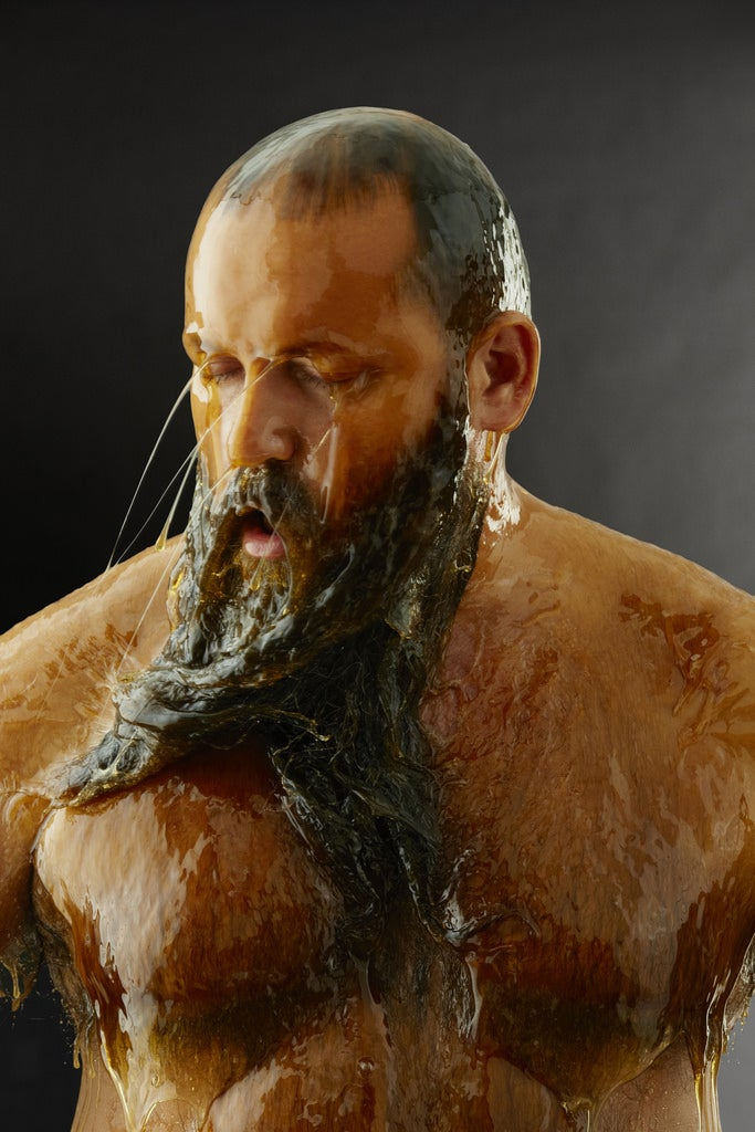 You have to watch these naked people completely covered in honey (NSFW)
