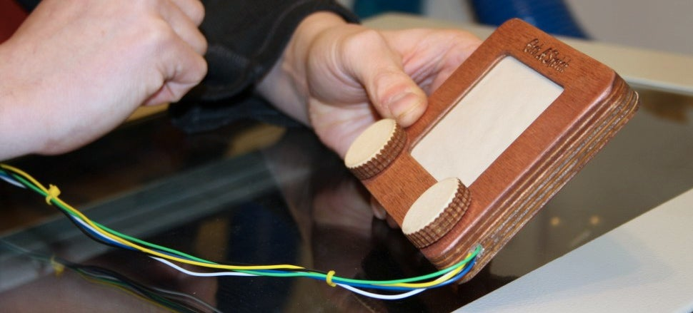 An Etch A Sketch Laser Cutter Makes Your Crappy Drawings Permanent