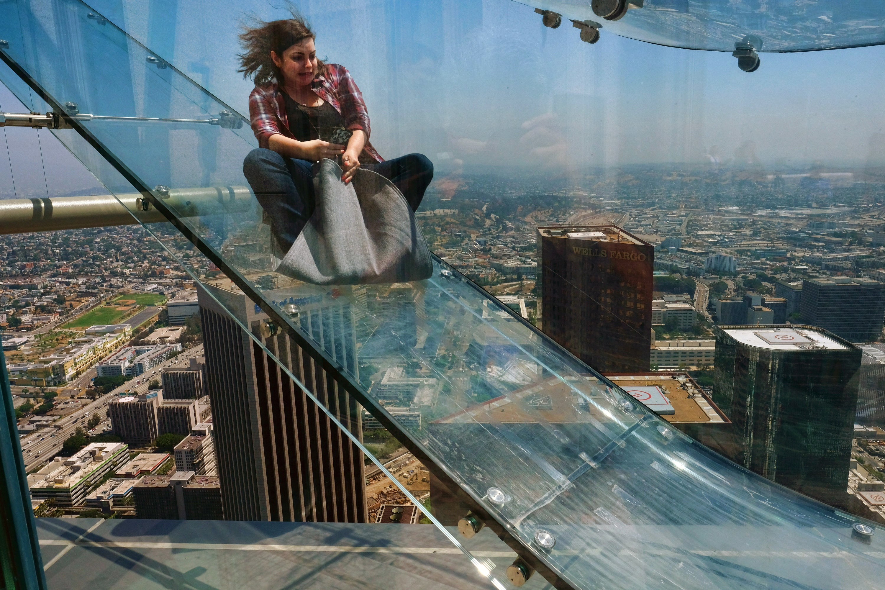 The Most Terrifying Glass Slide Ever Opens Atop L.A. Skyscraper