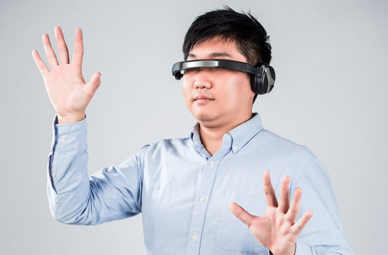 The Future Of Tech Is Sideways Headphones (According To Stock Photos)