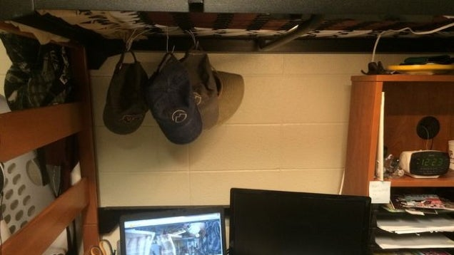Store Baseball Caps On Your Bunk Bed With a Wire Hanger
