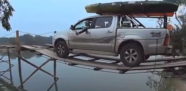 Watching a Truck Towing a Boat Drive Over a Flimsy Wooden Bridge Is So Stressful