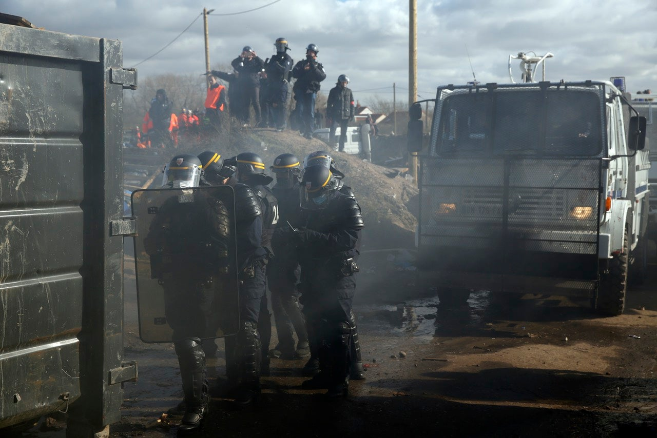 France's Destruction of a Migrant Camp Looks Like a Scene From They Live