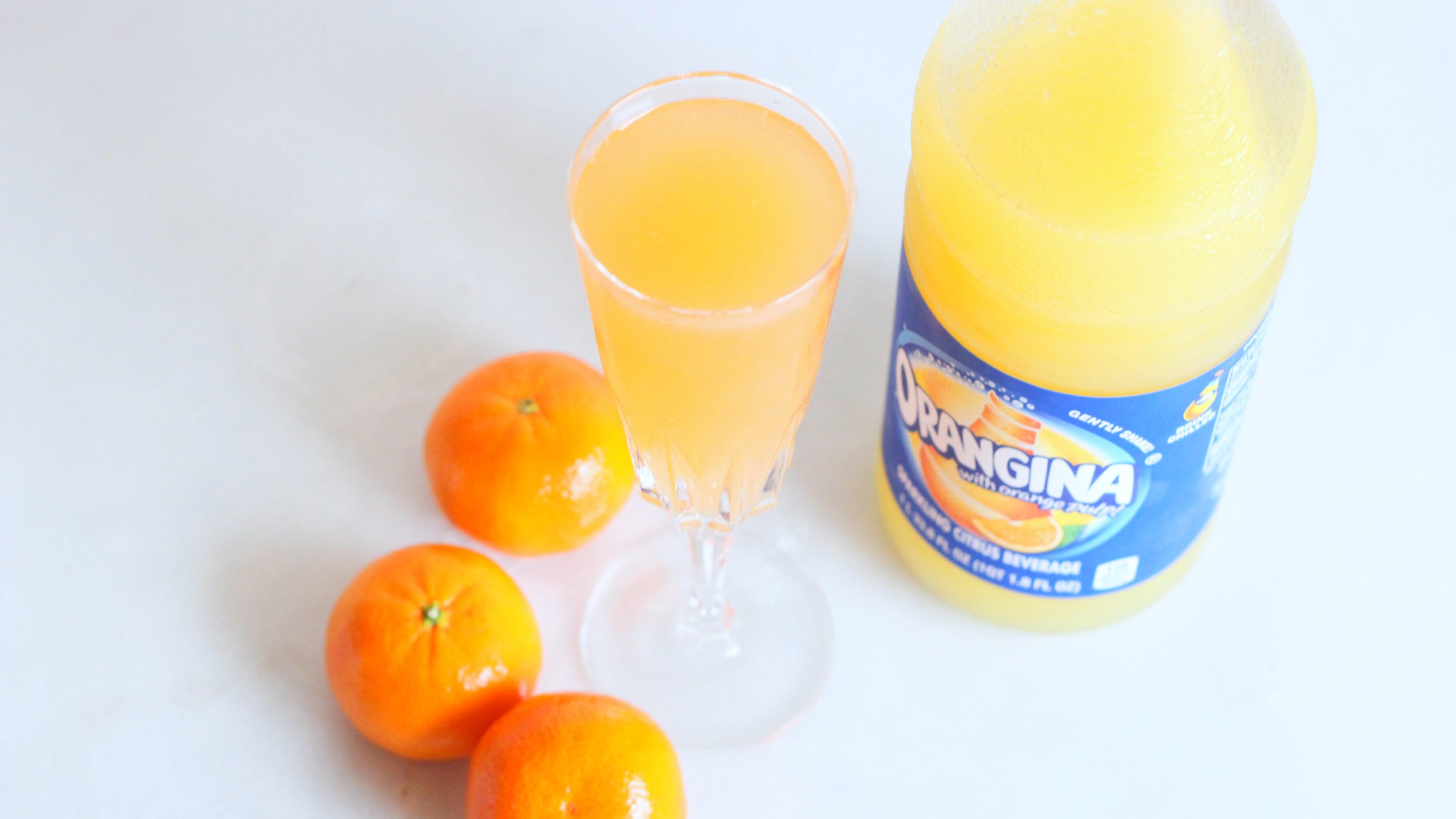 Get Sunny With An Orangina Cocktail