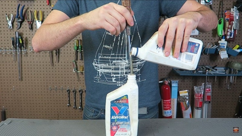 Use A Screwdriver As A Makeshift Funnel