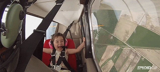 Seeing this kid fly in a stunt plane with her dad is true joy