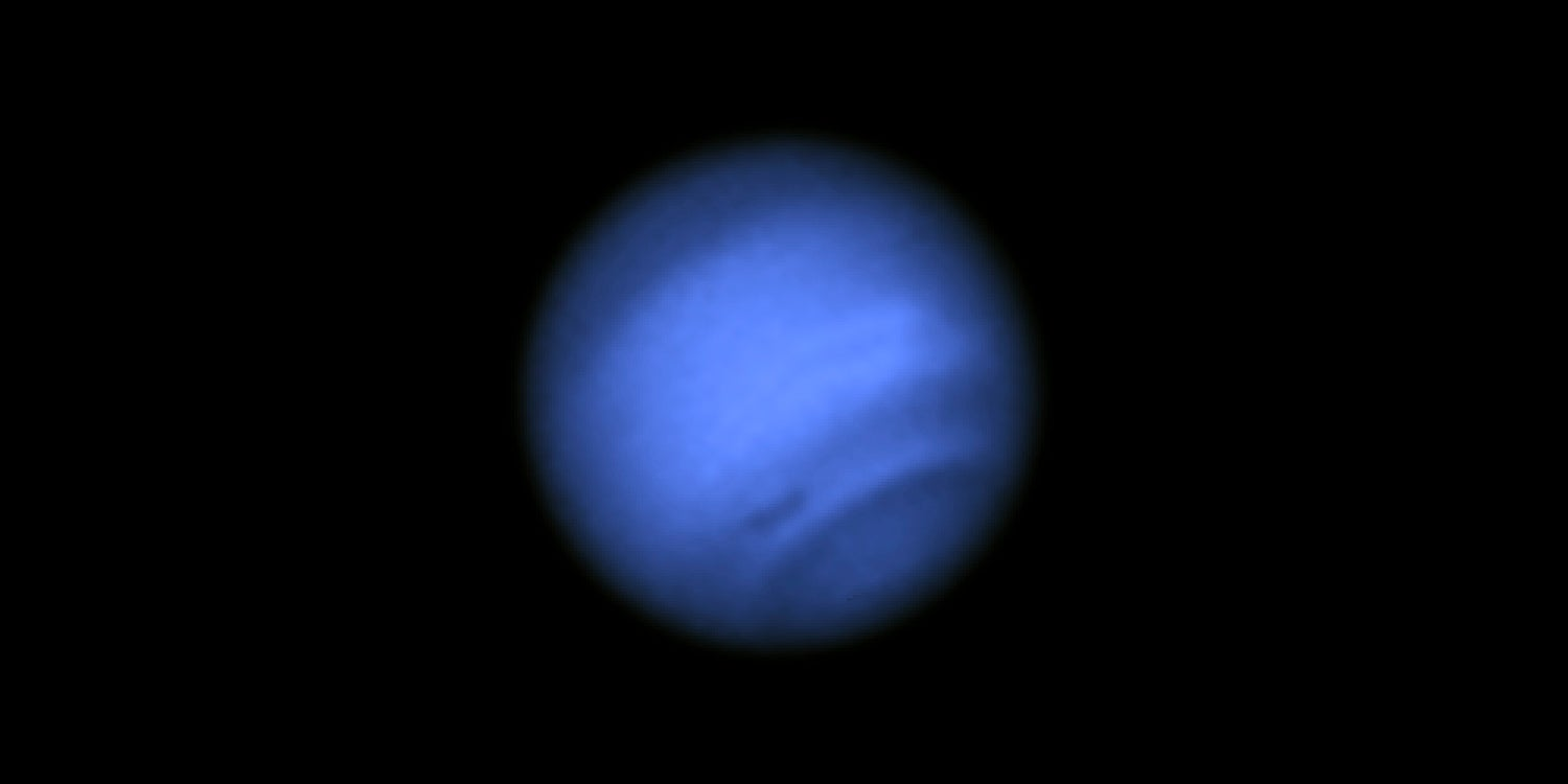 A Mysterious Dark Vortex Just Appeared Over Neptune