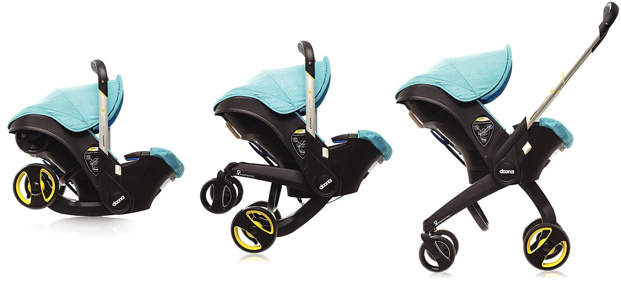 A Car Seat With Retractable Stroller Wheels Frees Up Trunk Space