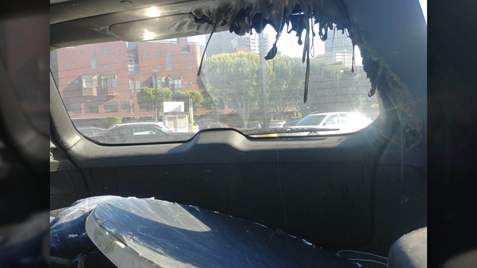 Here's Why You Shouldn't Leave A Giant Parabolic Mirror In Your Car On A Sunny Day
