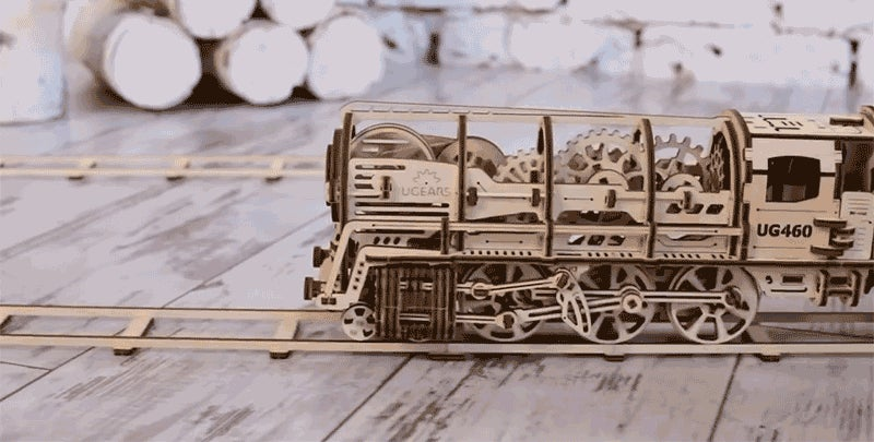 Look at all the Wonderful Wooden Gears Inside This Elastic-Powered Locomotive
