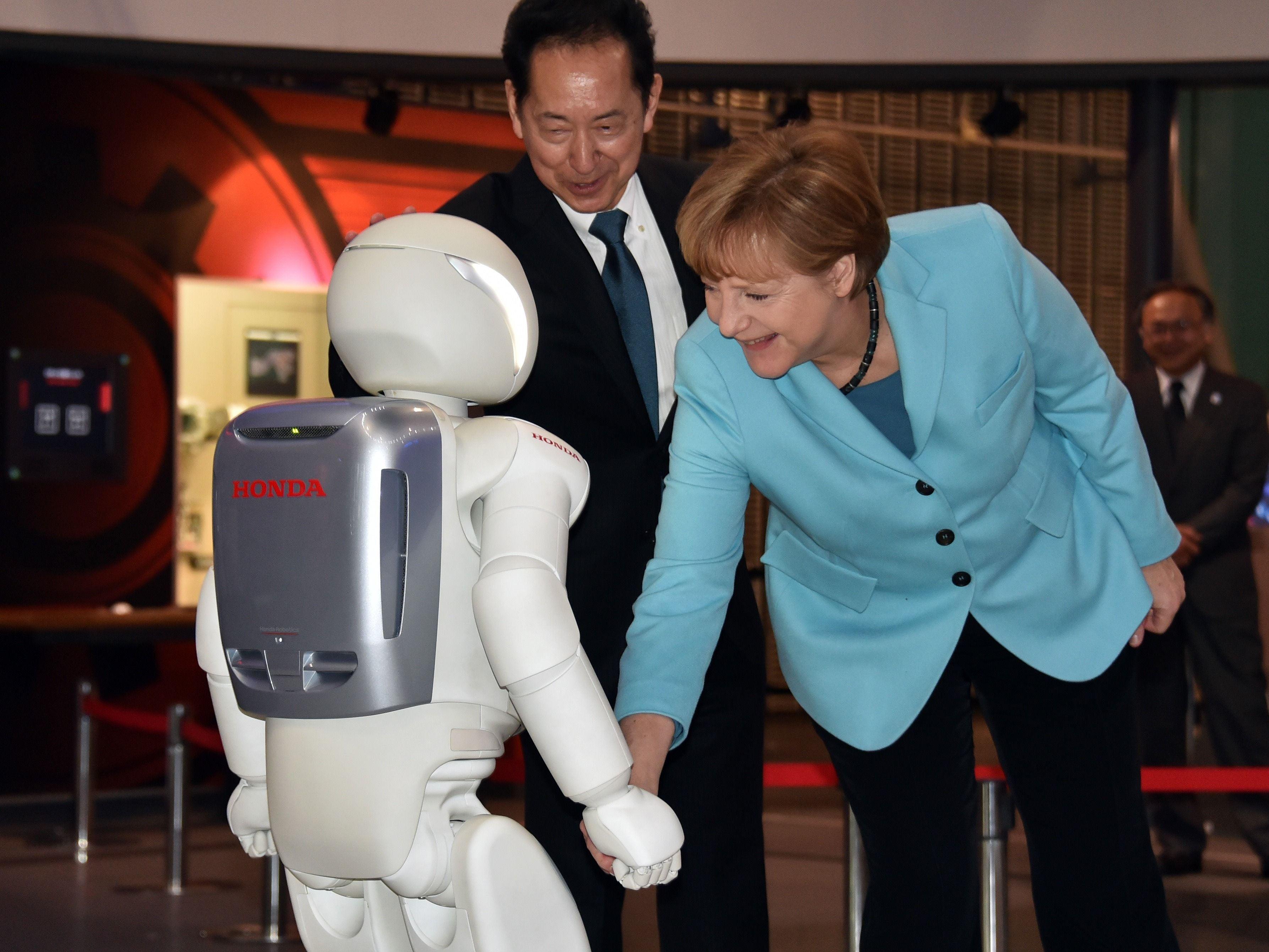 Why Is Angela Merkel Always Palling Around With Robots?