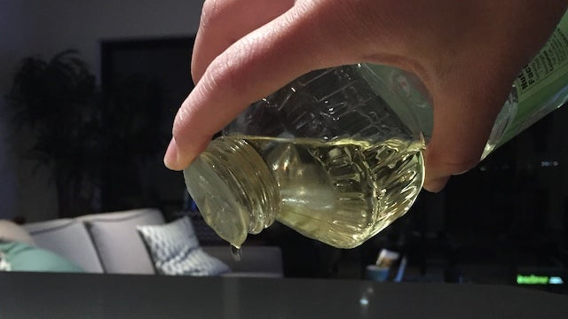 Poke Holes in the Seal of a Cooking Oil Bottle for Better Control