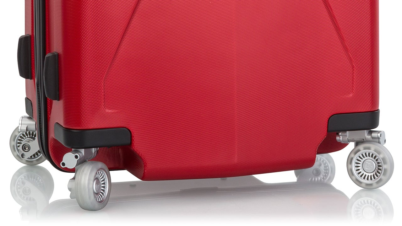 The First Suitcase With Wheels That Retract So They Don't Get Destroyed