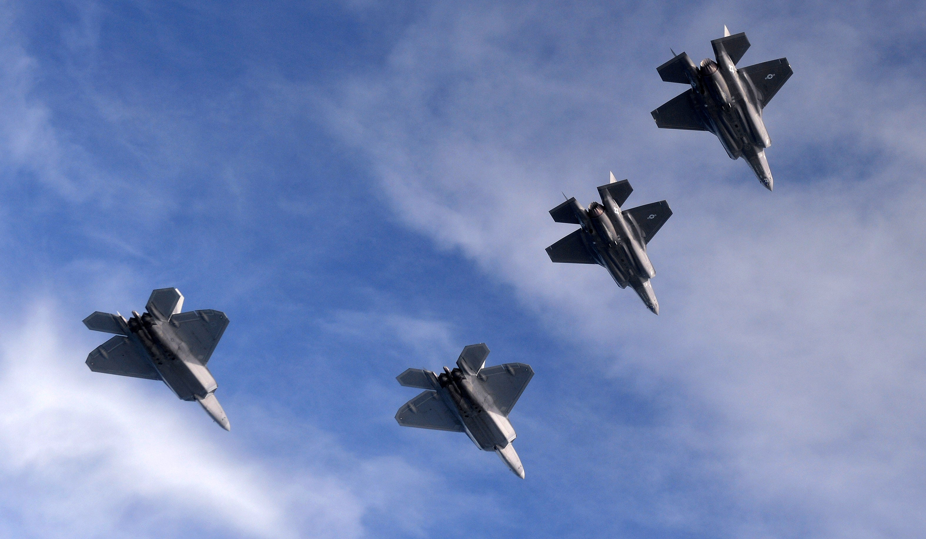 Cool photos of F-22s and F-35s flying together for the first time