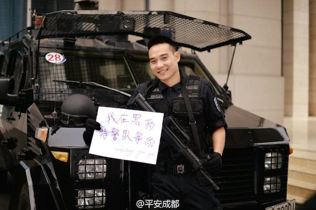 Chinese SWAT Team Recruits With Smiles And Crossbows