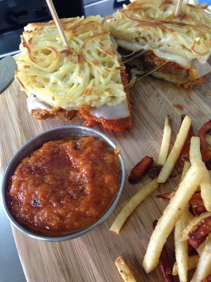 A spaghetti bun and meatball sandwich is evolution at its finest