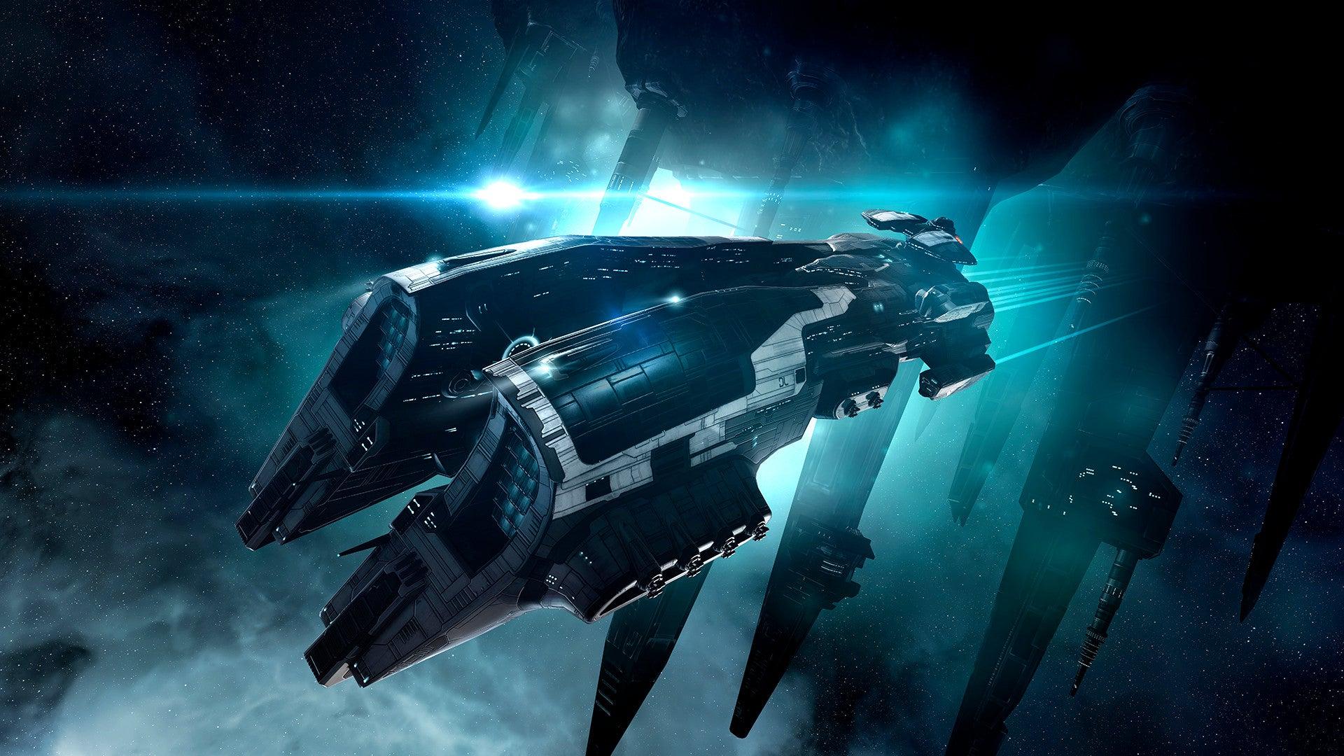 青い光を放つ宇宙船画像