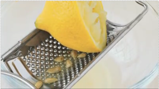 Squeeze Citrus Over a Grater to Catch Seeds
