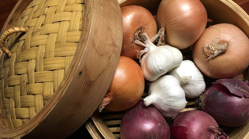 Use Your Steamer Basket to Store Onions and Garlic