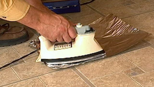 Fix Curling Vinly Floor Tiles with a Clothes Iron