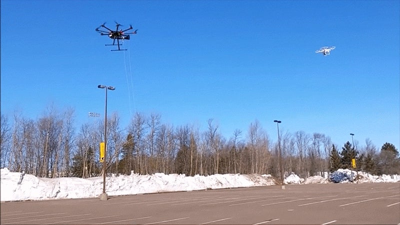 This Drone Catches Another By Firing a Net Right at It