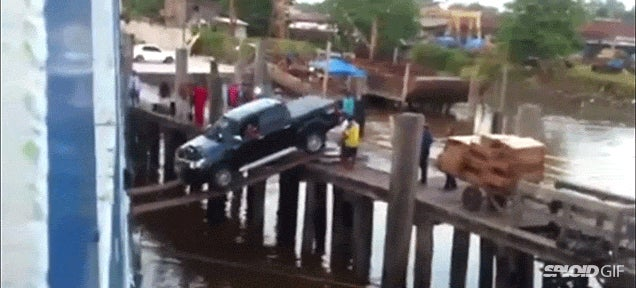 Truck boards a ship by wildly driving down two thin wooden planks