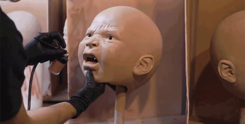 Making Oversized Baby Masks Might Be The Creepiest Thing You