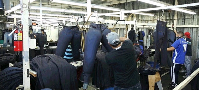The Weird Methods Used to Make Brand New Jeans Look Old