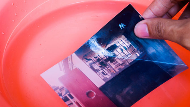 Save Sticky Photographs by Soaking Them in Lukewarm Water