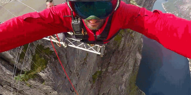 Watch This Daredevil Dive 1,300-Feet Off A Cliff Using Nothing But A Rope To Stop His Fall